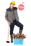 Carpenter holds stop sign Stock Image