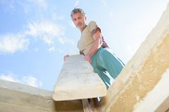 Carpenter or homeowner fitting section wood Stock Photo
