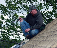 Carpenter on a house roof Stock Image
