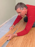 Carpenter installing floor Royalty Free Stock Image