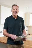 Carpenter Installing Luxury Fitted Kitchen Stock Photo