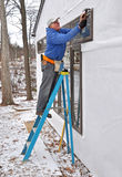Carpenter installing windows. In an addition royalty free stock images