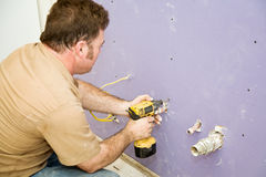 Carpenter Installs Drywall royalty free stock photo