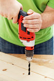 Carpenter or joiner drilling hole Royalty Free Stock Photography