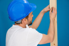 Carpenter or joiner marking a measurement Royalty Free Stock Image