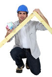 Carpenter kneeling Royalty Free Stock Photo