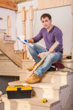 Carpenter on ladder Royalty Free Stock Photo