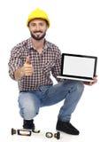 Carpenter with laptop Stock Photos