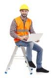 Carpenter with laptop Royalty Free Stock Photos