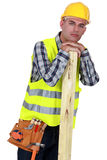 A carpenter leaning Stock Image