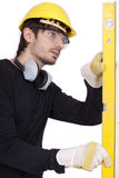 Carpenter with level Royalty Free Stock Photography