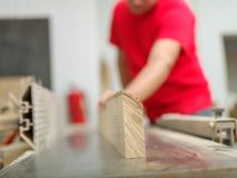 The carpenter is leveling the timber bar in the workplace Royalty Free Stock Image