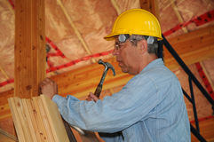 Carpenter in a loft Royalty Free Stock Photos