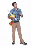 Carpenter looking disgruntled Stock Images