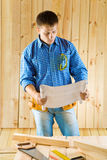 Carpenter looks on blueprint Royalty Free Stock Photo