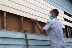 A carpenter maintenance the house. royalty free stock images
