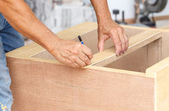 Carpenter make new furniture for house royalty free stock photos