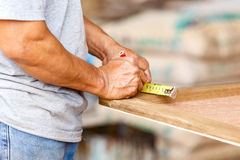 Carpenter make new furniture for house Royalty Free Stock Photography