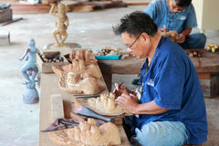 Carpenter makes wooden Handicraft Stock Photo