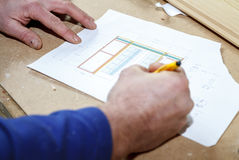Carpenter making drawings Royalty Free Stock Images