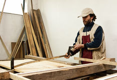 Carpenter making furniture Royalty Free Stock Images