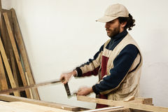 Carpenter making furniture royalty free stock photo