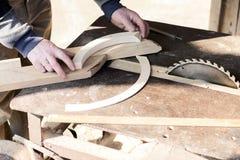 Carpenter is making furniture Stock Photos
