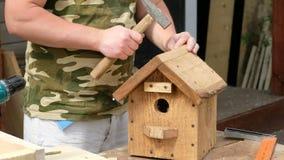 Carpenter making wooden nest box in workshop, close up. Carpenter making wooden nest box in workshop stock video footage