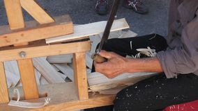 Carpenter making wooden tiles stock video