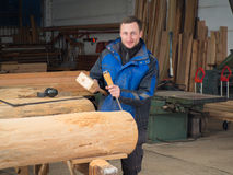 Carpenter with mallet and chisel. In his workshop Stock Photos
