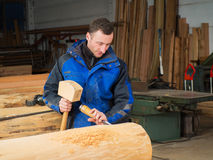 Carpenter with mallet and chisel. In his workshop Royalty Free Stock Images