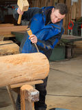 Carpenter with mallet and chisel. In his workshop Royalty Free Stock Photo