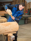 Carpenter with mallet and chisel. In his workshop Stock Photography
