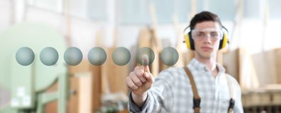 Carpenter man touch screen with empty symbol icons on carpentry background stock images