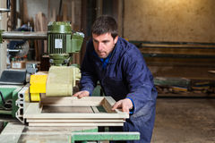 Carpenter man working with tablesaw in workshop Royalty Free Stock Photo
