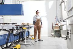 Carpenter man works with wooden planks in the joinery, with computer numerical control center, cnc machine,  isolated on a white. Background stock images