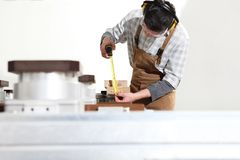 Carpenter man works with wooden planks in the joinery, measure with meter, with computer numerical control center, cnc machine,. Isolated on a white background stock photography