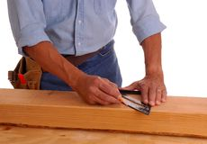 Carpenter marking cut line Royalty Free Stock Photography