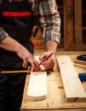 Carpenter marking Stock Photo