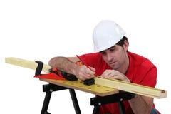 Carpenter marking wood Royalty Free Stock Photos