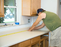Carpenter Measures Counter Top Stock Photo