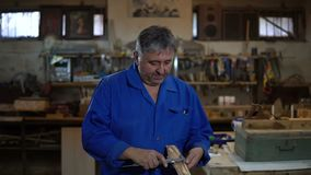Carpenter measures a piece of wood with a caliper. In the workshop stock video