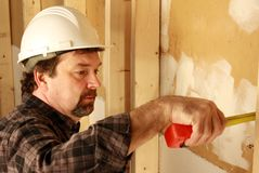 Carpenter measuring Royalty Free Stock Image