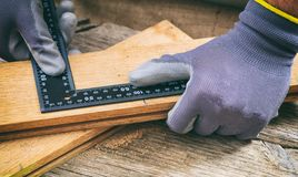 Carpenter measuring with a metal angle Royalty Free Stock Photography