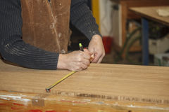 Carpenter measuring Royalty Free Stock Photography