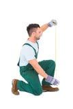 Carpenter measuring something Royalty Free Stock Image