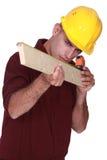 Carpenter measuring  wood Stock Photos