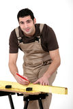 Carpenter measuring wood Stock Image
