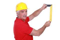 Carpenter with meter Stock Photo
