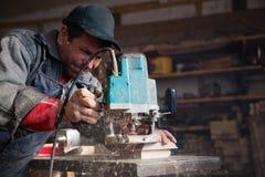 Carpenter milling machine processes the wood element Stock Image